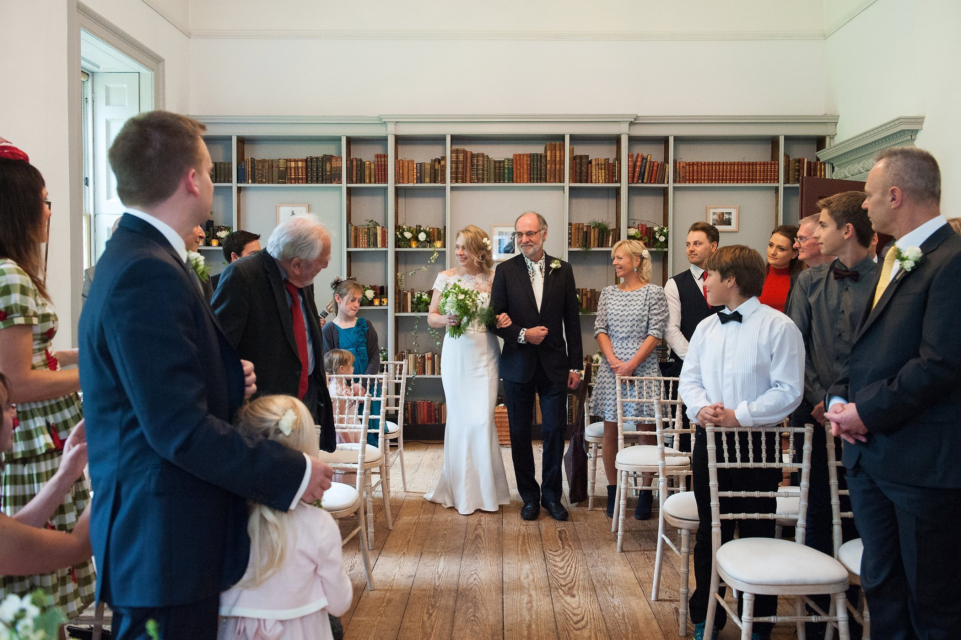 Bride & her father walk into Bishop Terrick's Drawing Room at Fulham Palace at the start of a civil marriage cermony