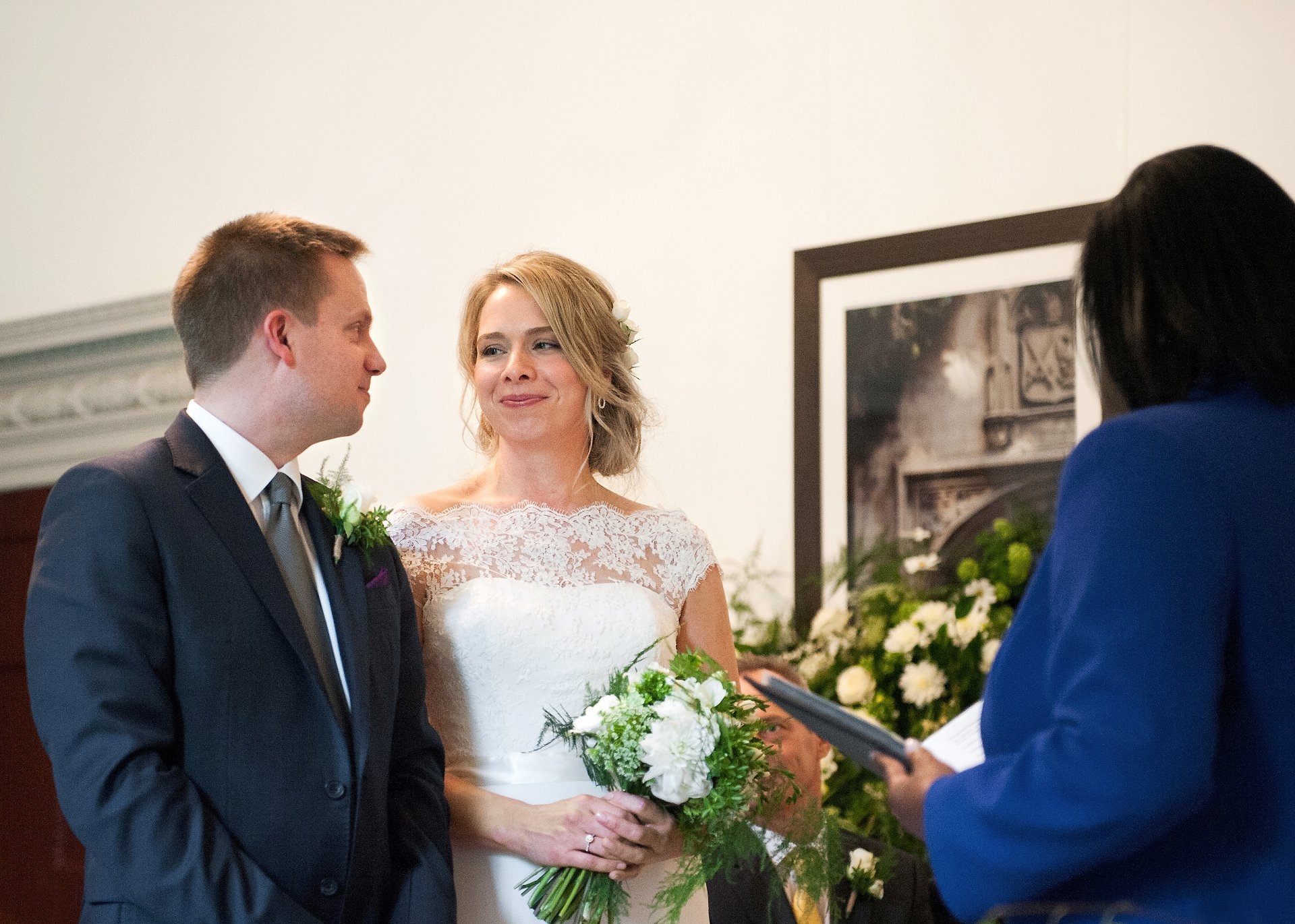 Bride & groom smile during their Fulham Palace wedding ceremony