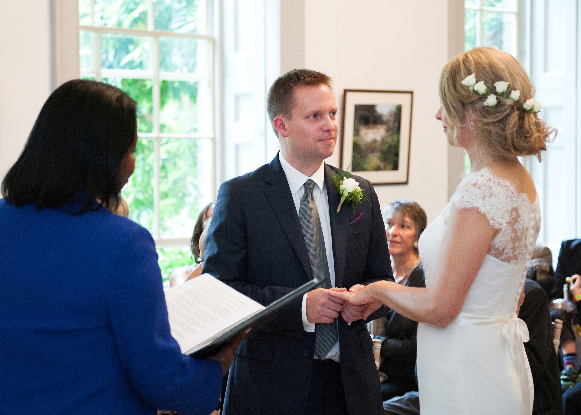 Exchange of vows and rings in Bishop Terrick's Drawing Room during a wedding ceremony