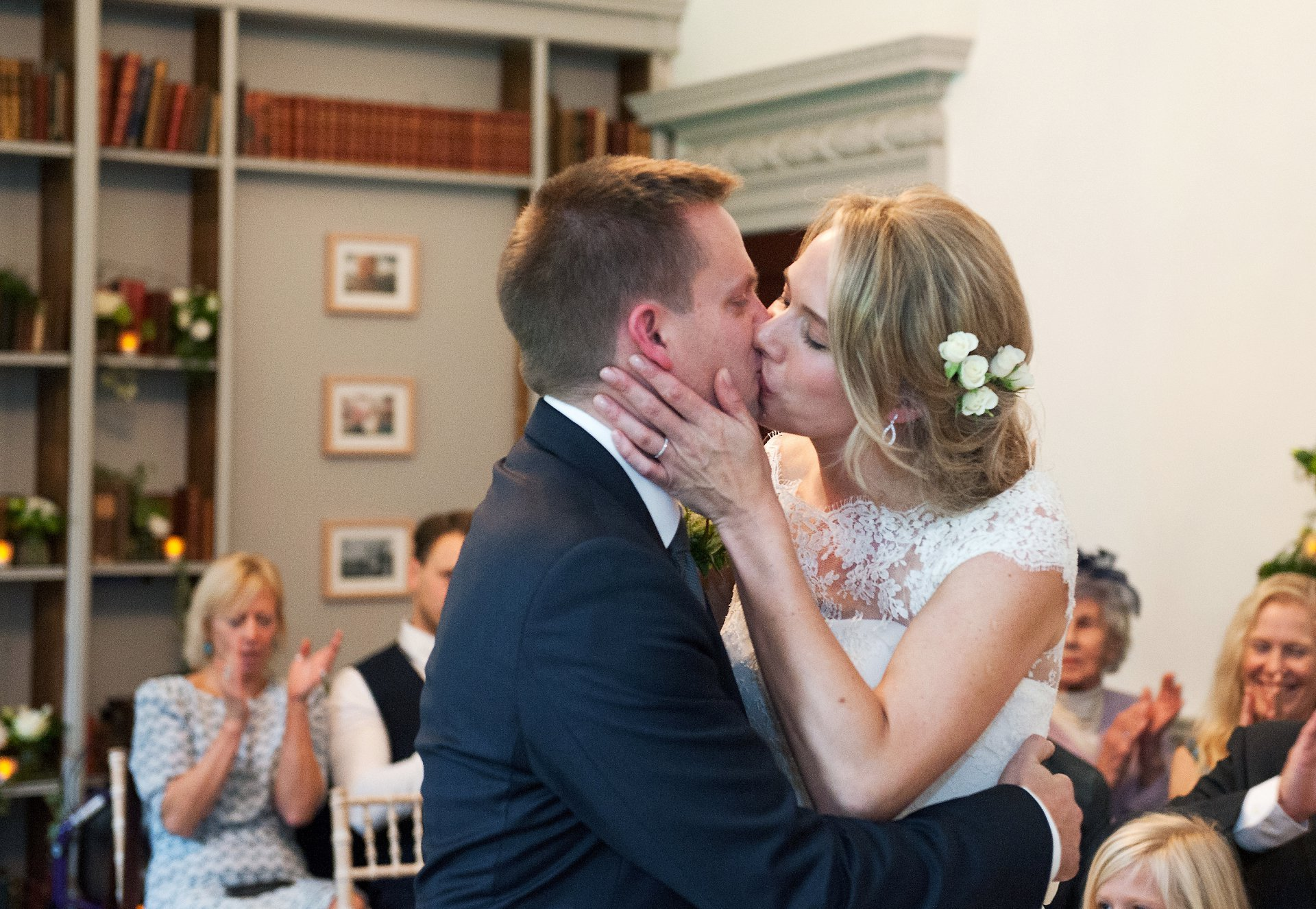 Bride & groom kiss after their Fulham Palace civil ceremony