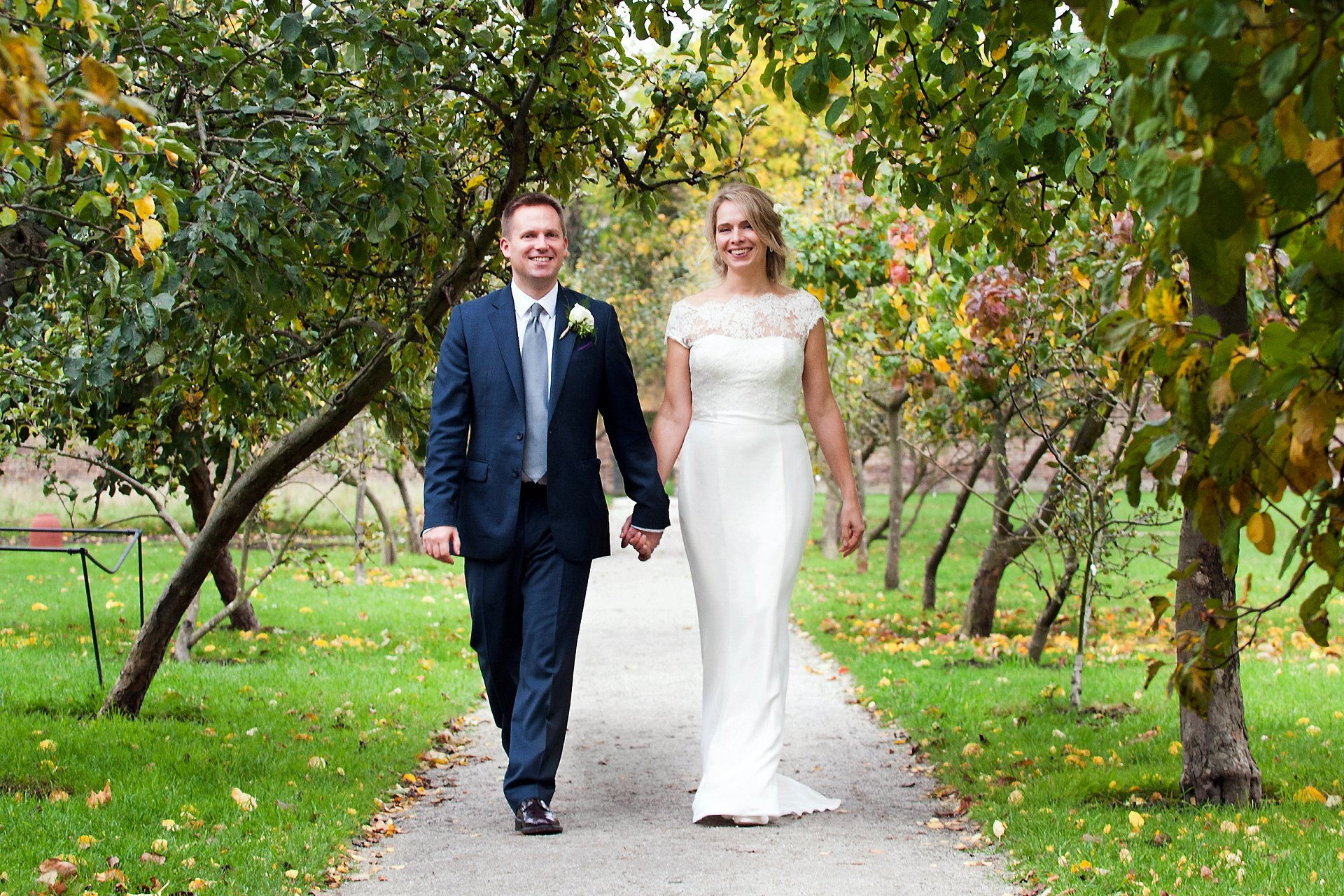 Fulham Palace wedding photographer Emma Duggan with a bride and groom in the orchard in Fulham Palace's walled garden