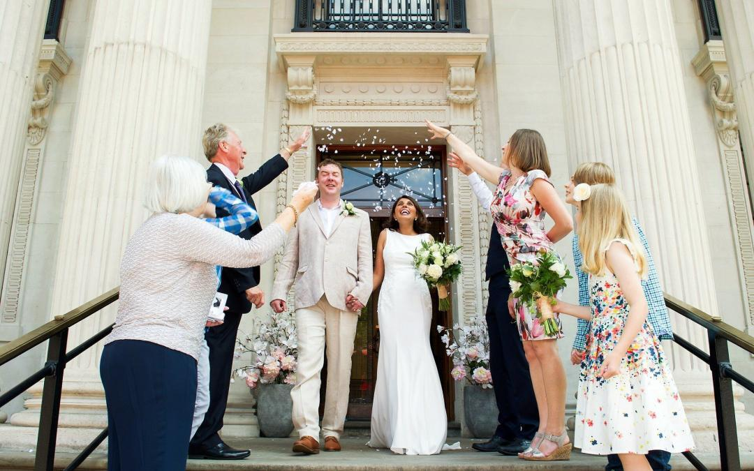 confetti on the iconic old marylebone town hall steps wedding photography by recommended supplier emma duggan