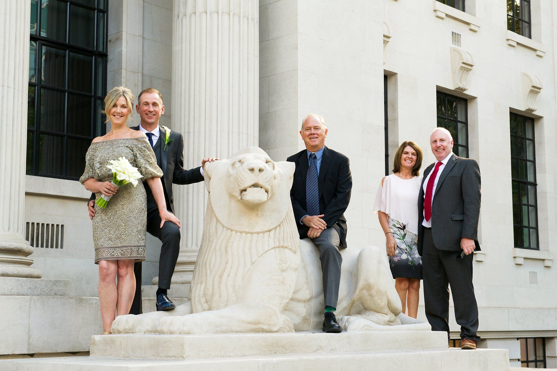 a group photograph incorporating an old marylebone town hall stone lion