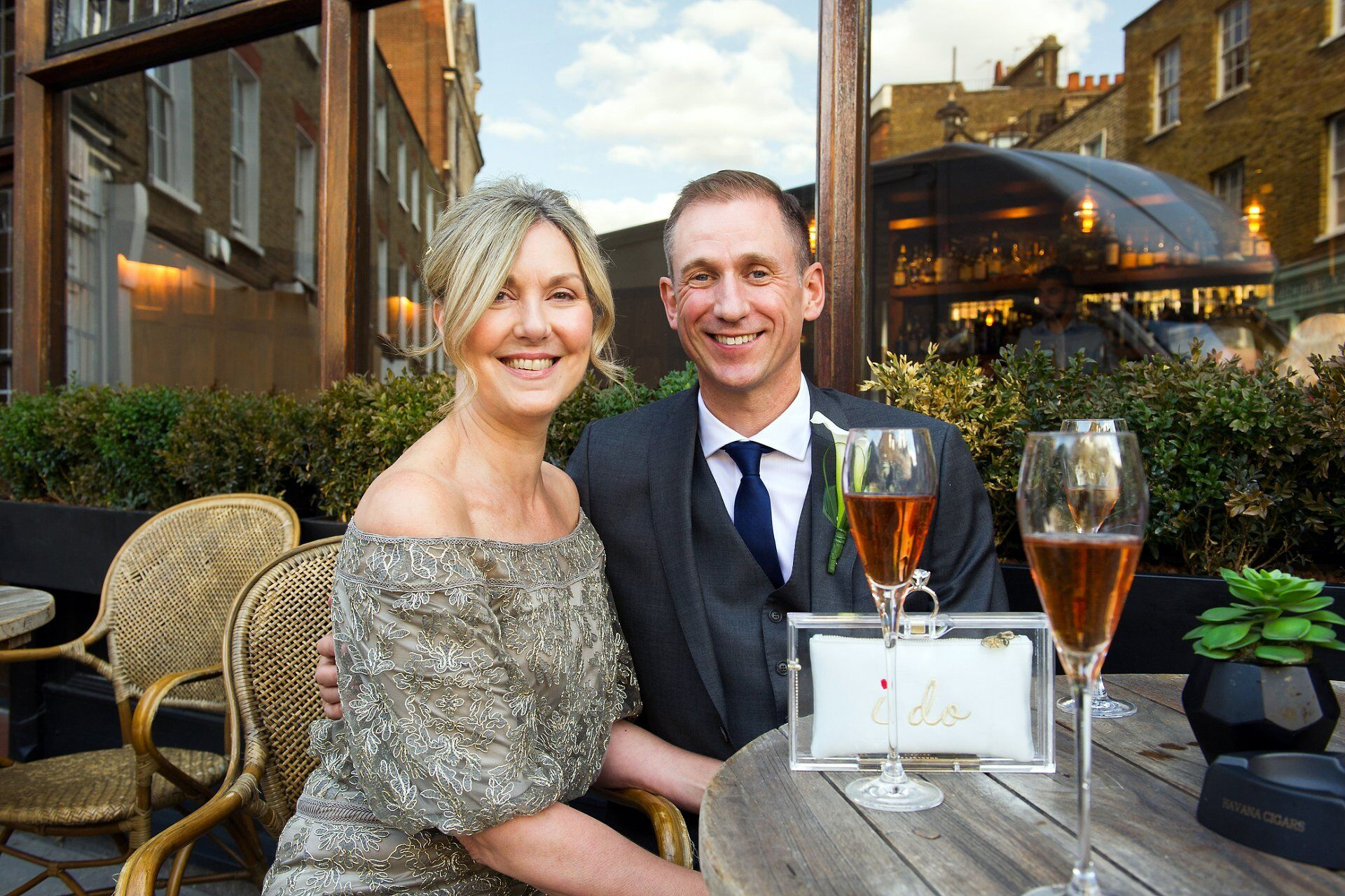 brenda and michael pose with pink champagne outside the harcourt just off york street in marylebone after their westminster registry office wedding