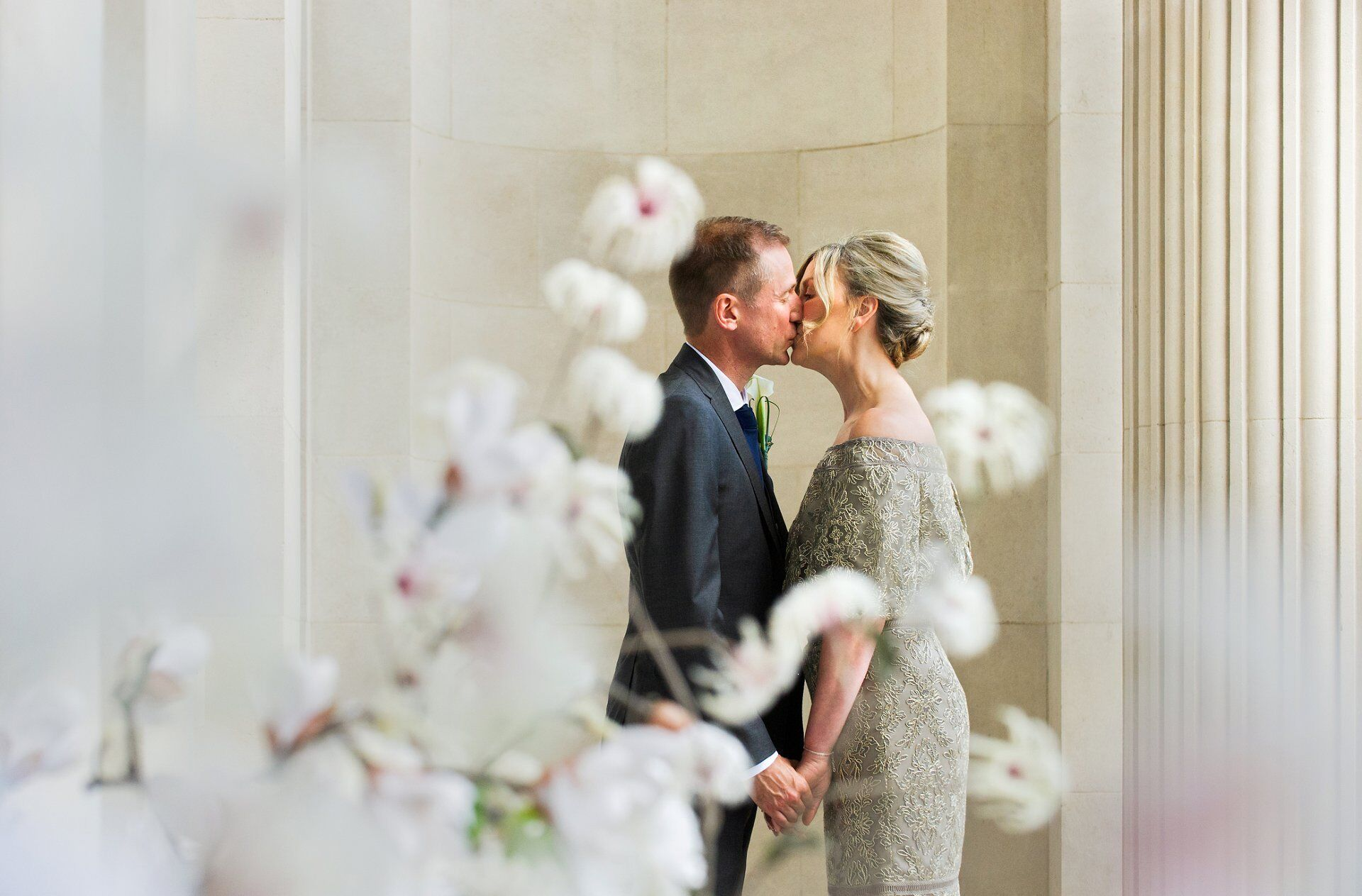 brenda and michael share a private kiss after their paddington room wedding ceremony by old marylebone town hall wedding photographer emma duggan