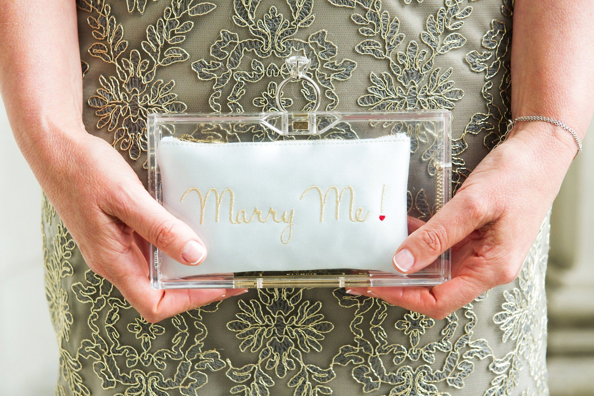 bride holding a charlotte olympia marry me clutch with engagement ring closure westminster register office wedding photography by emma duggan