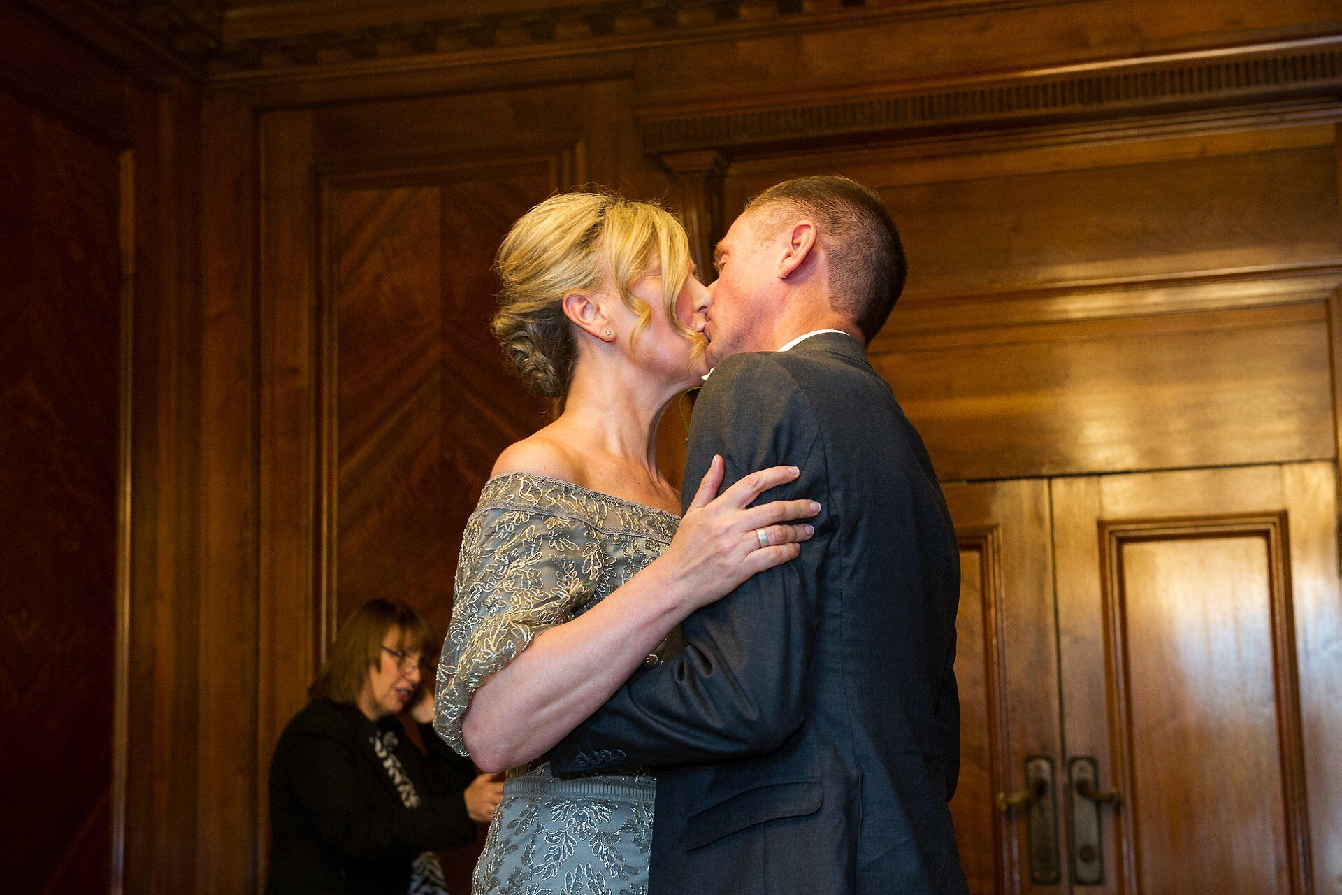 first kiss for brenda and michael as husband and wife in the paddington room at old marylebone town hall
