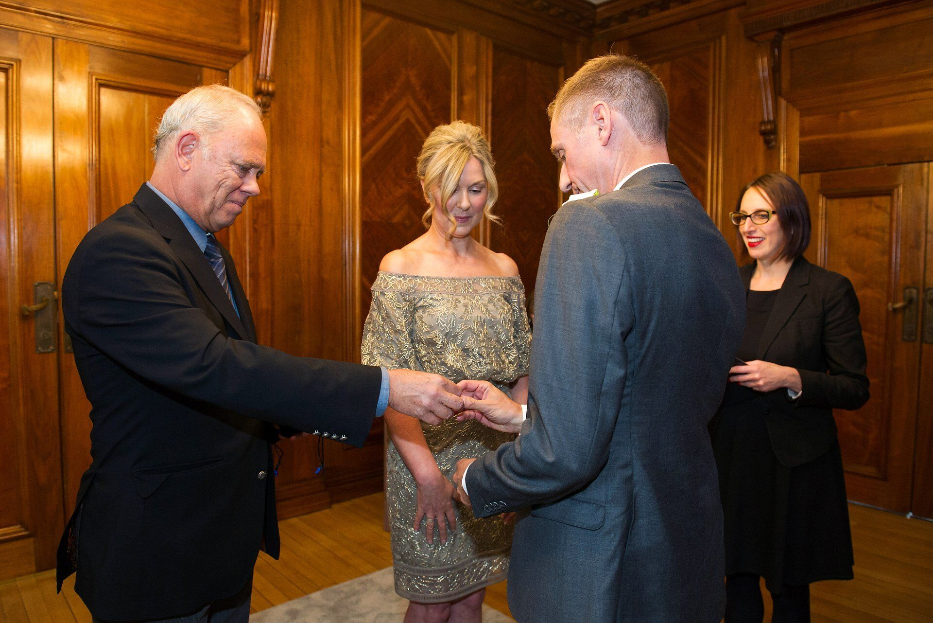 guest brings the wedding rings forward for michael and brenda in the paddington room at westminster council house