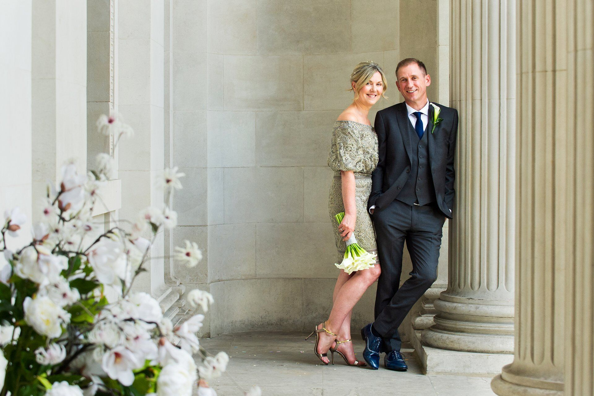 old marylebone town hall wedding photography by a professional covering over 100 weddings at this iconic london venue brenda and michael underneath the fluted columns