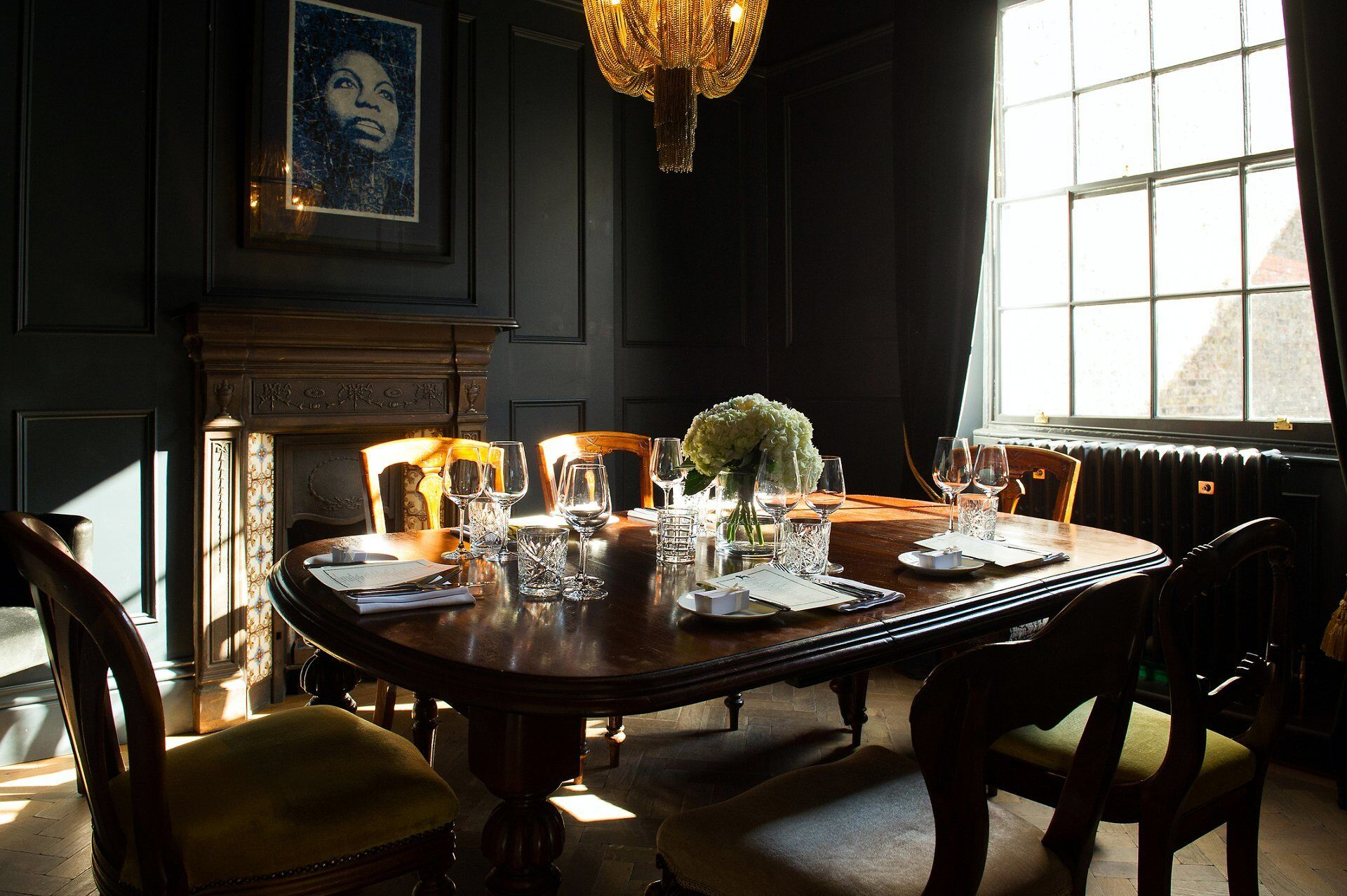 the black room the harcourt wedding photographer emma duggan and a table set for wedding breakfast and sun shining in through the window