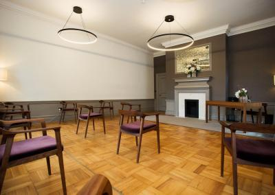 mayfair oom social distancing layout seen from the back of the room showing ten chairs for guests