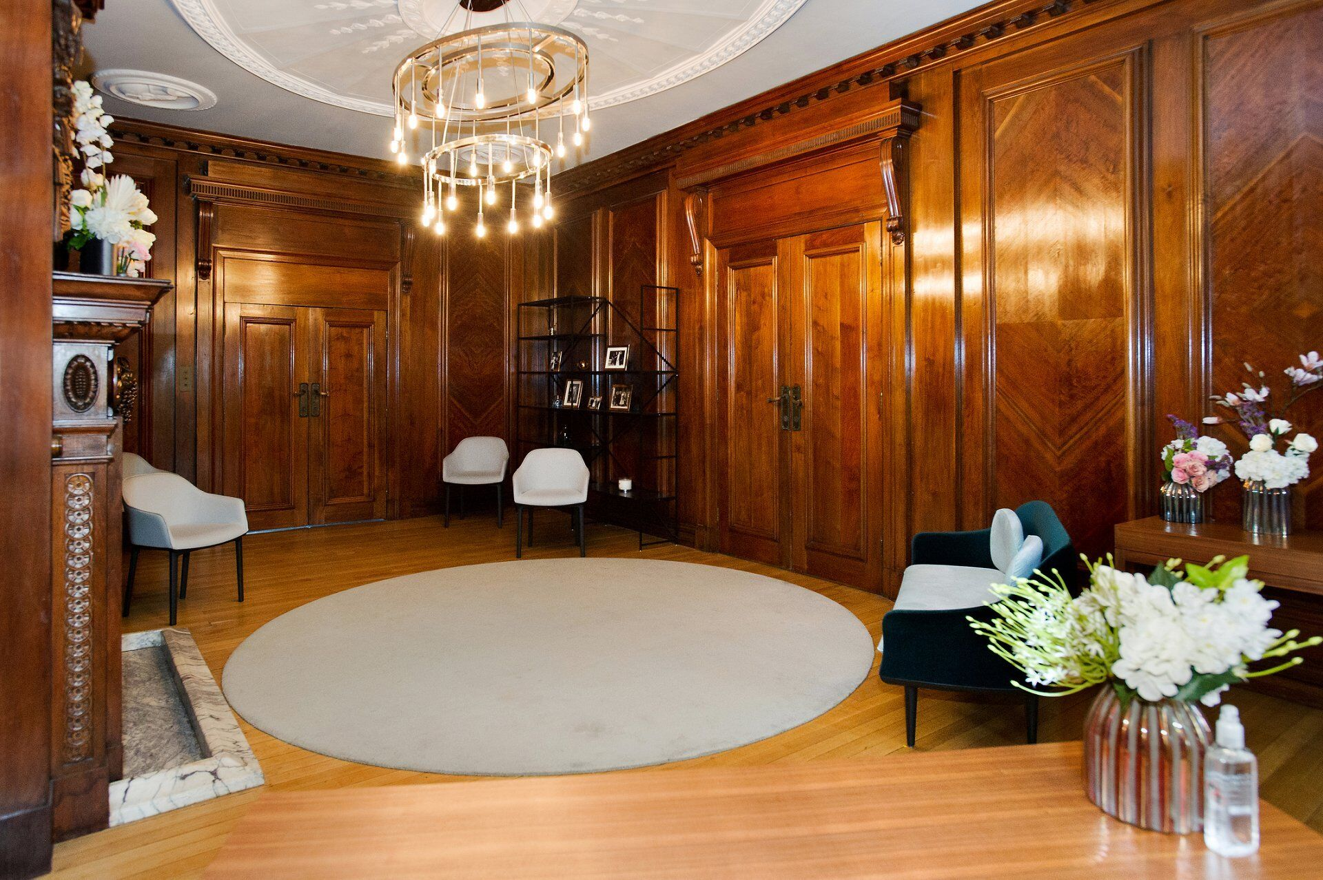 the marylebone room seen from the signing table showing seating for up to 6 guests and antibacterial gel on each table
