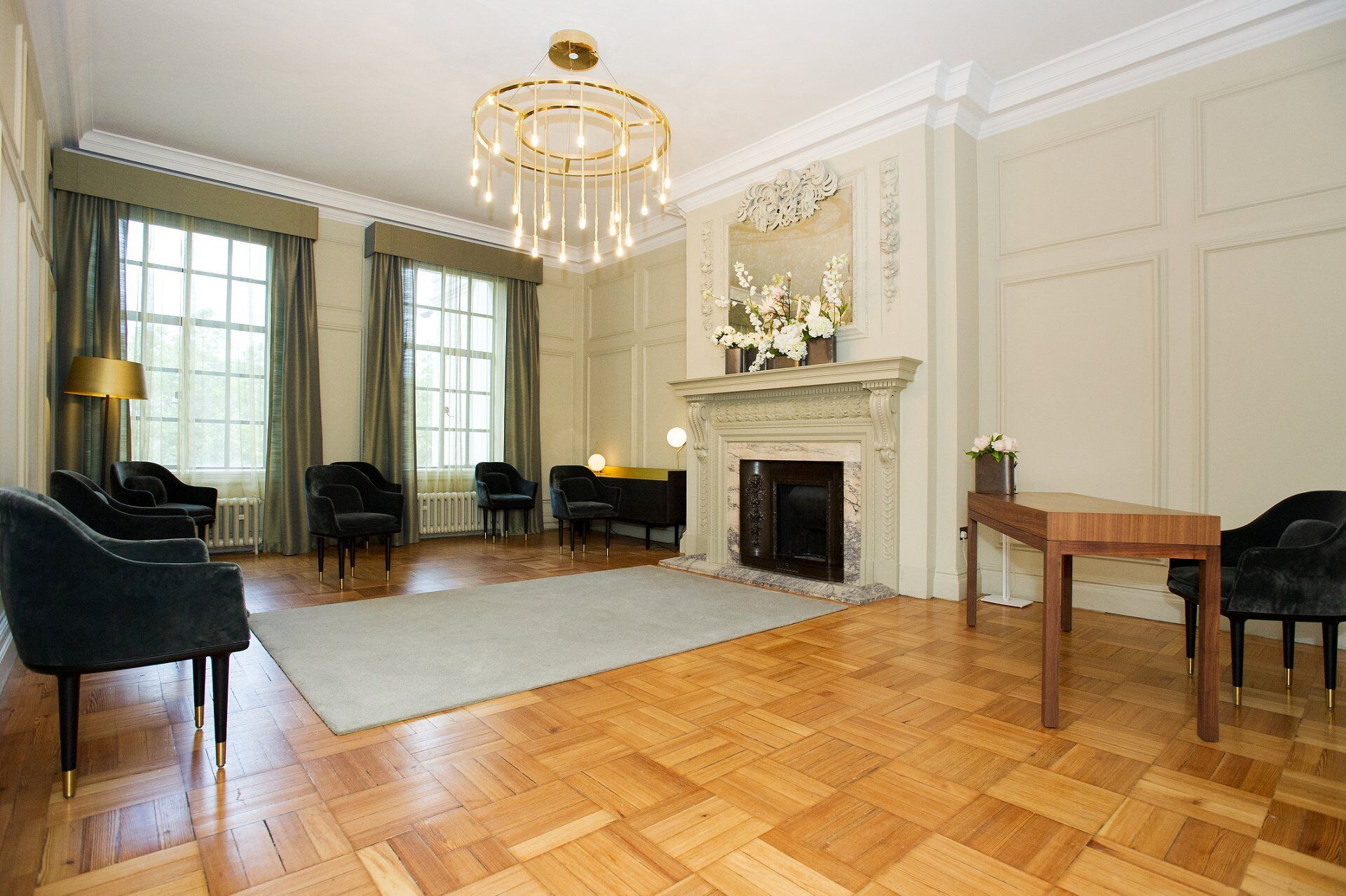 old marylebone town hall new ceremony room layouts the pimlico room seen from the door showing seating for 7 guests with couple in front of fireplace and the registrar near the door