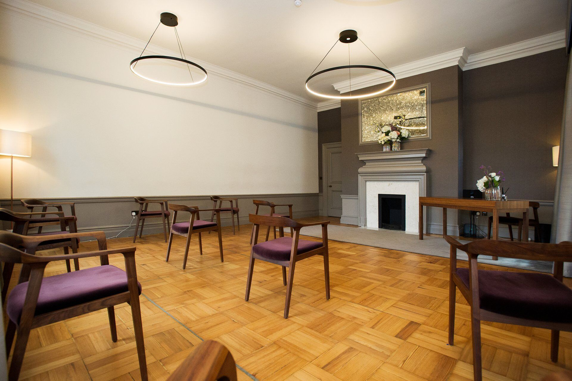 view from the rear of the mayfair room showing ten socially distanced chairs